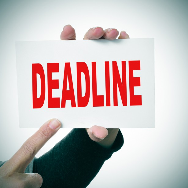 woman hand holding a signboard with the word deadline written in it