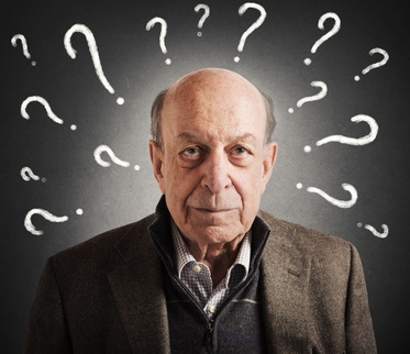 Old man confused with many question marks